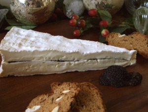 Brie with black truffles, cow milk cheese available to sell